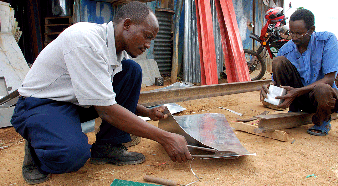 Artisan Benjamin Njue from Embue, Kenya teaches other artisans how to make metal silos